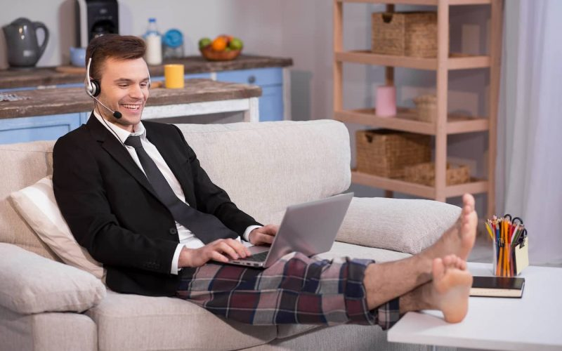 SW-workingfromhome-feature-man-sitting-on-sofa-with-laptop